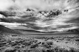 """Photo: Aguereberry Mining Camp, Death Valley. 2011.  The same weather front that deprived us of a sunset on sunday, yielded beauties like this one. We were walking back from one of the most fun shoots I've done with +Lotus Carroll , +Karen Hutton , and +Thomas Hawk of an abandoned old rusted out car. I took a few photos of this landscape, then remarked: """"Sure wish there was some light on the buildings"""". Just as I had put the camera away the clouds parted over the buildings and we had light.  Ask and you shall receive.  #DV2011 #DV2011_RicardoLagos #PlusPhotoExtract"""