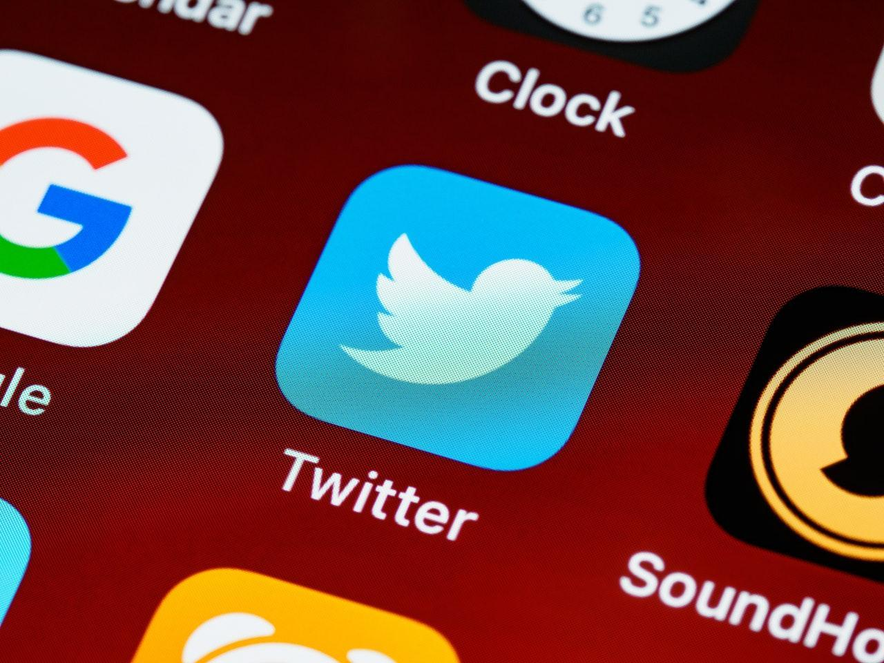 Close up of a Twitter app icon on a phone screen