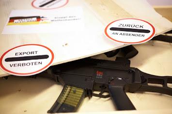 Waffen und 2 Verbotsschilder.jpg