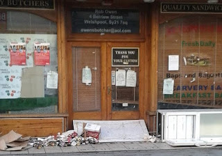 Council planning benches in empty shop doorway