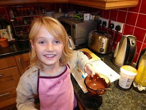 Photo: Katie preparing a chocolate and orange cake