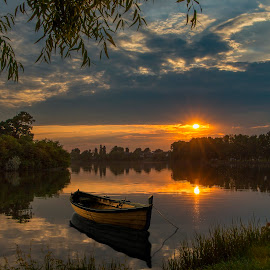 Chill sunset. by Marius Olbosan - Landscapes Sunsets & Sunrises ( water, reflection, nature, grass, no people, sunset, outdoors, tranquil scene, trees, lake, tranquility, beauty in nature, day, boat,  )