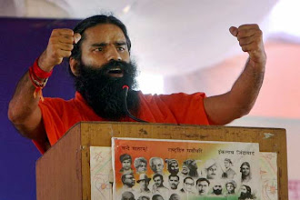 Photo: Ramdev vows to sink UPA's boat in 2014 elections http://t.in.com/0q7o