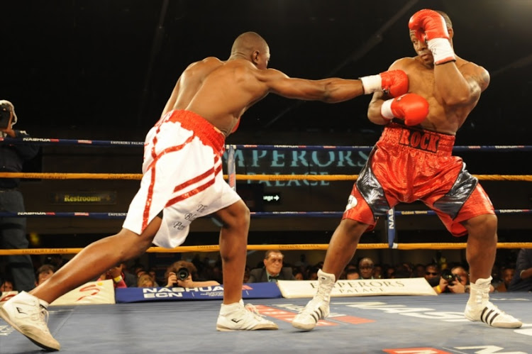 Flo Simba (White trunks) and Thabiso Mchunu (Red trunks) during the Cruiserweight bout between Thabiso Mchunu and Flo Simba at Emperors Palace on September 22, 2012 in Johannesburg.