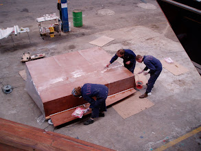 Photo: Reinforcing the bottom of the deckpod with fiberglass