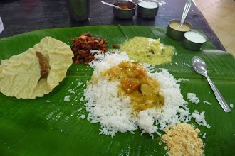 Photo: Thali or Meal(s) at the Maharaja Restaurant on Triplicane High Road, Chennai. Served on a banana leaf. It is expected that you eat with hands (preferably your right) but on request they can find you a spoon or fork. Cost about 25 - 35 US cents in 2004.  Dosai Making In Puri http://www.youtube.com/watch?v=7Pwe7IsFDyY&list=UUOWXy3pH6EQJsCMU4_wseBA