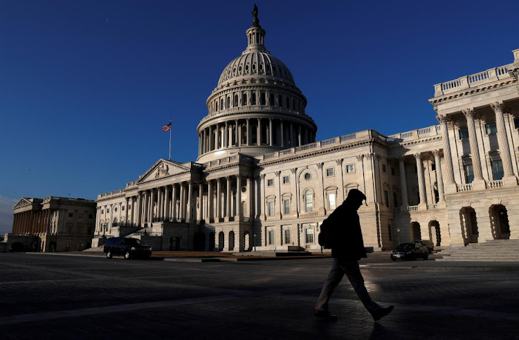 A man walks by the US Capitol building in Washington, US, in this February 8 2018 file photo. Picture: REUTERS/LEAH MILLIS