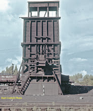 Photo: 078-01.  Front of coaling tower with drop bottom gondolas, loaded with coal, on ramp behind.  7/28/60.