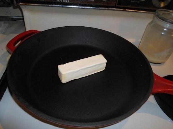Turn burner to medium heat. Melt butter in a large iron skillet.