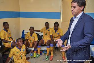 Photo: Coach McKinstry speaks with the players at half time[Rwanda vs Uganda, CECAFA 2015 Final, 5 Dec 2015 in Addis Ababa, Ethiopia.  Photo © Darren McKinstry 2015, www.XtraTimeSports.net]