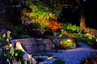 Photo: You don't need to be stuck on the deck. Lighting makes the whole landscape beautiful and usable.