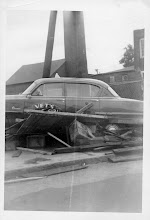 Photo: A taxi is destroyed by flood debris. Photo taken by John William McElhone, submitted by Jack Sheedy.