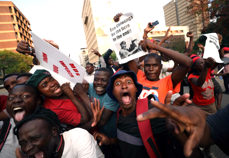 Jubilation: Zimbabweans celebrate after Robert Mugabe resigned as president on Tuesday. The bombshell news was delivered by the parliament speaker to a special joint session of the assembly that had convened to impeach Mugabe. Picture: REUTERS