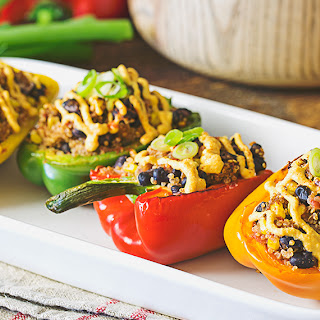 Dairy-Free Stuffed Bell Peppers With Vegan Queso Sauce.