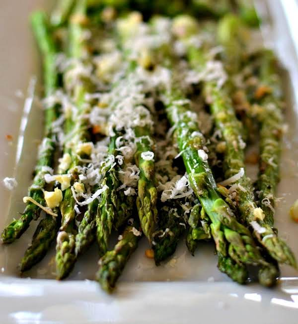 Oven Roasted Parmesan Asparagus Is A Quick And Easy Side Dish Combining Healthy Asparagus, Minced Garlic And Freshly Grated Parmesan Cheese.  This Tasty Side Is One Of My Go To Recipes For Easy Weeknight Meals.