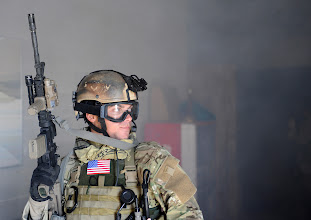 Photo: A U.S. Air Force pararescueman searches for simulated casualties in a smoke-filled building during a tactical rescue scenario at an undisclosed U.S. location during exercise Patriot Archangel Oct. 18, 2009. The exercise hones Guardian Angel combat operations skills in simulated hostile urban environments and increases combat effectiveness for pararescuemen. (U.S. Air Force photo by Staff Sgt. Jason Robertson/Released)