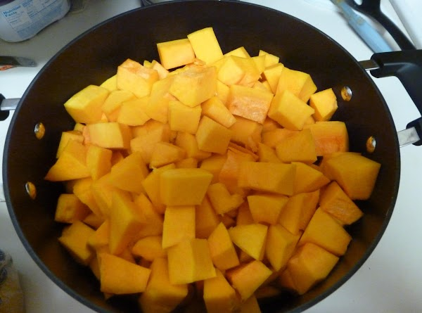 Peel the butternut squash and cut it into 1 inch cubes