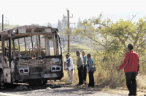 TORCHED: One of the buses that were burnt down north of Durban by unknown gunmen. © Sowetan.