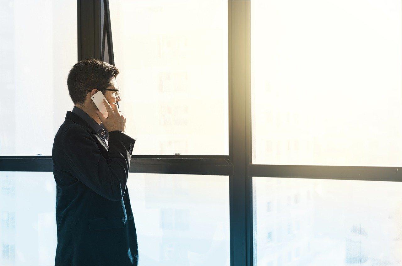 a man talking on a phone