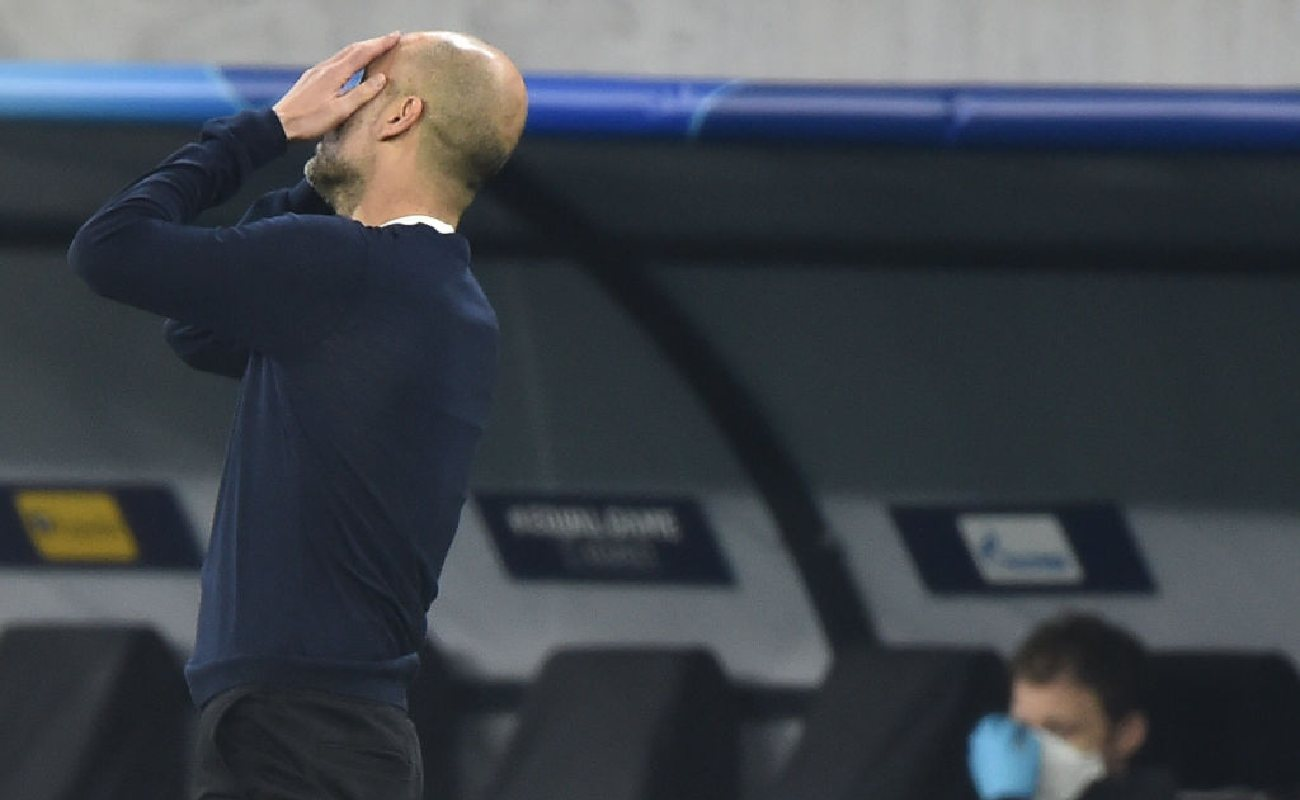 Alt: An exasperated Pep Guardiola holds his hands in front of his face on the sideline - Photo by ATTILA KISBENEDEK/AFP via Getty Images