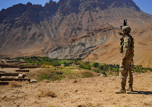 Photo: FARAH, Afghanistan 110926-F-JP934-062 / U.S. Army Staff Sgt. Brendan Quinn, from Foxboro, Mass., of 1-182 Infantry Regiment, Charlie Company, security force for Provincial Reconstruction Team Farah, provides security while on patrol,  Purchaman District, Farah Province, Afghanistan, Sept. 26. PRT members escorted members of Farah's Provincial Government to a shura where elders resolve community issues and communicate concerns to the provincial government. PRT Farah attends shuras throughout Farah Province to demonstrate support for the shura elders, the district governor and provincial governance. (ISAF photo/ USAF SrA Alexandra Hoachlander)