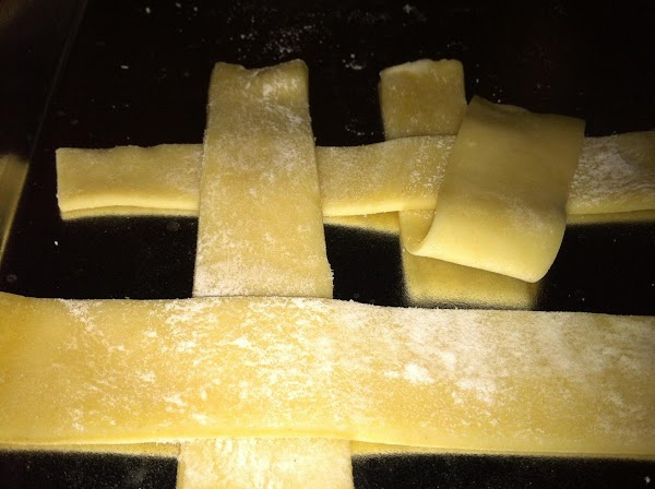 Over lap and under lap four strips of pie crust.  Dab a little water between strips at intersections (this