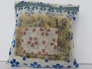 Photo: Stenciled muslin sachets filled with flowers