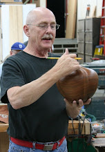 "Photo: John turns his hollow vessels to a thickness of 1/4"" - 3/8"" depending on how deeply they will be carved or textured. They typically dry in 7 - 10 days in a cabinet he uses for that purpose. He uses no special handling techniques during the drying process other than the restricted air movement offered by the enclosure."