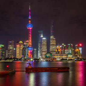 The Bund at Night by Griff Johnson - City,  Street & Park  Skylines ( canon, water, reflection, asia, the bund, pearl tower, long exposure, cityscape, shanghai, colours, nightscape, china )