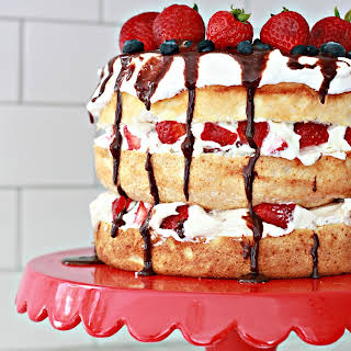Summer Berry Angel Food Cake with melted chocolate.