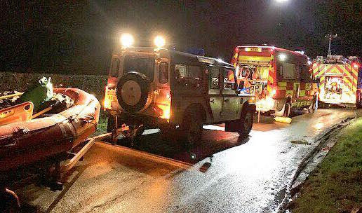Pair rescued from car trapped in floods