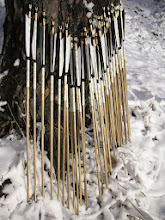 Photo: pine wood, spindle shaft, gold painting, horn inserts, brass points, 6 inch feathers.