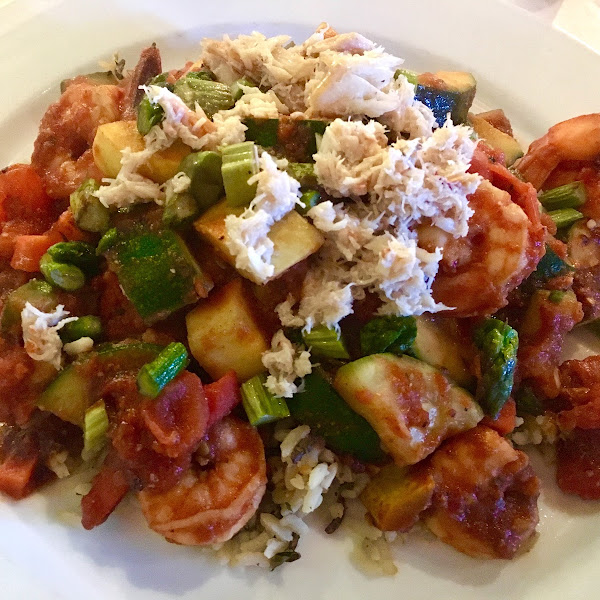 Killer Shrimp Creole Jumbo shrimp in a hearty vegetable creole sauce. Served over sweet potato dirty rice and topped with an asparagus and lump crab relish. $23.50