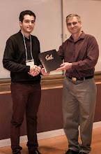 Photo: Walid Krichene accepting the EECS Outstanding GSI Award.