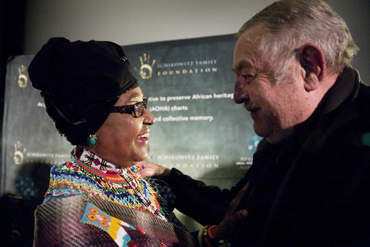 Winnie Madikizela-Mandela speaks to apartheid-era foreign minister Pik Botha at the premiere of 'Plot for Peace' in Johannesburg on July 27 2014.