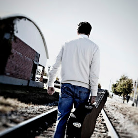 Playing the Latest Tracks by Cody Miller - People Musicians & Entertainers ( canon, walking, 24-70, male, train, 2.8l, musician, guitar, day, case, tracks, man )