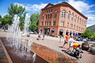 Photo: Aspen, Colorado, USA - July 06, 2012 Pedestrians walking the central street of Aspen, Colorado. Seen during summer afternoon with the fountain and the historic bank building.