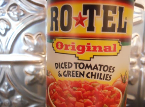 Stir in 1/2 cup cheese, Rotel tomatoes and black beans.  Prepare cornbread according...