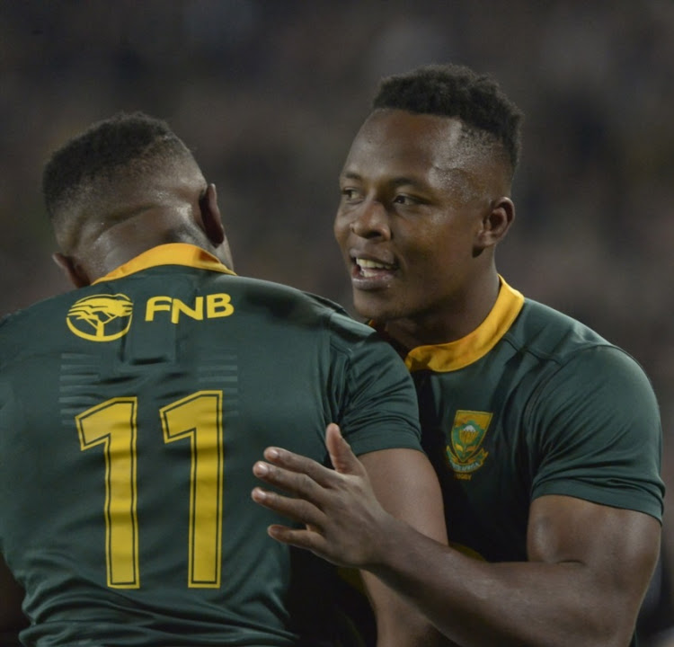Aphiwe Dyantyi being congratulated by S'busiso Nkosi during the 2018 Castle Lager Incoming Series match between South Africa and England at Ellis Park on June 09, 2018 in Johannesburg, South Africa.