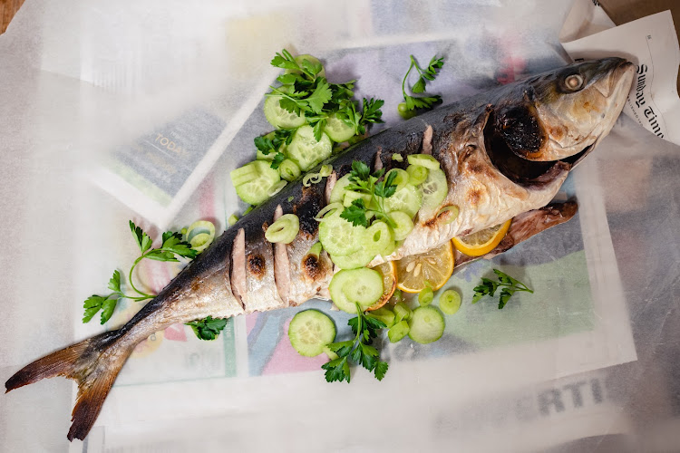 Whole grilled yellowtail with fennel, cucumber and parsley salad.