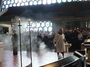 Photo: Incense and cross precede the procession of the monks and ministers.