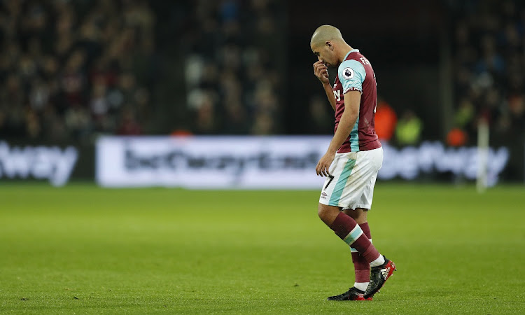 West Ham United's Sofiane Feghouli looks dejected after being sent off. Picture: REUTERS