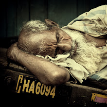 Photo: Wish I can sometimes nod off at work ... then again, I'd probably be too lazy afterwards to get back behind the desk. A courier catching up on some sleep on his wooden cart in Mumbai, India. www.michiel-delange.com #streetphotography  #streetphotographers  #India  #mumbai
