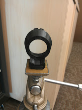 Photo: Canon FD to telescope lenspiece camera adapter, with tripod thread.