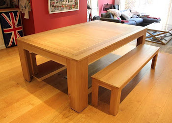 a light wooden table on light wooden flooring
