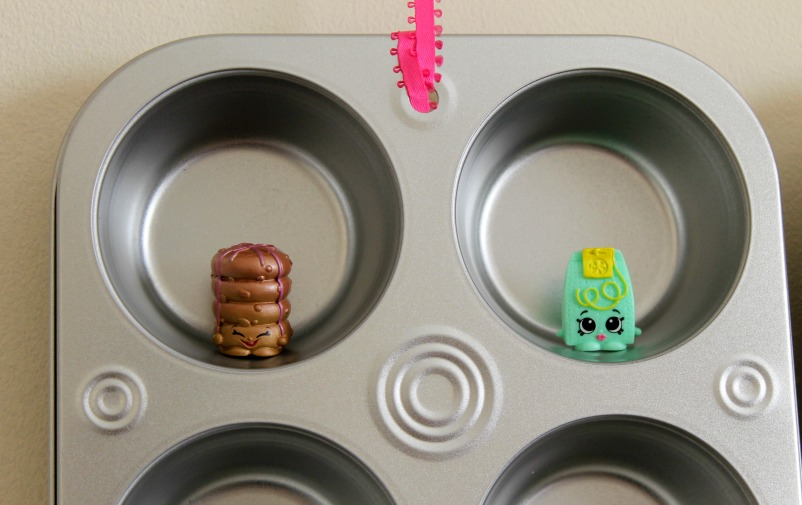 Fill the muffin tin wells with Shopkins!