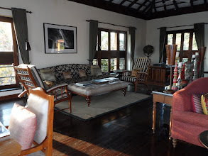 Photo: A very gracious sitting room area with bar and fire places.