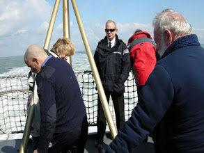 Photo: Captain watching lowering of ensign staff