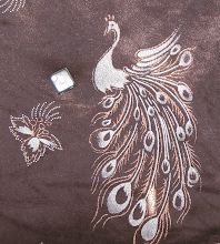 Photo: 50/50 cotton poly blend velvet, Chocolate brown with peacock print
