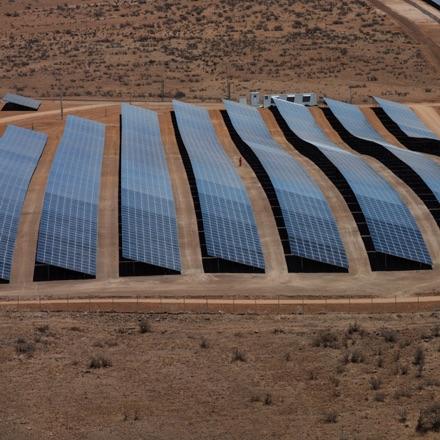 Solar panels collecting sunlight in a desert